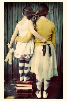 Sisters tied together.  We should do this Beth.  I want to wear the black and white stockings : )