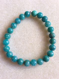 Russian Amazonite 8mm Round Stretch Bead Bracelet with Sterling Silver Accent by moonlovers on Etsy https://www.etsy.com/listing/216291480/russian-amazonite-8mm-round-stretch-bead