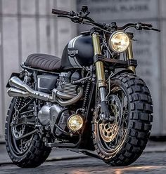 A bullet-ridden BMW from Sicily, a stunning Honda cafe racer from GT-Moto, and Ducati Scrambler tweaked an an Italian eyewear company. Moto Scrambler, Triumph Scrambler Custom, Custom Choppers, Moto Guzzi, Triumph Bonneville T100, Harley Davidson, R1200r, Cool Motorcycles, Vintage Motorcycles