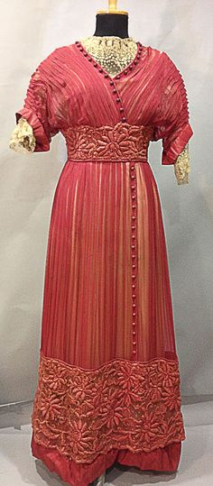 Day dress ca. 1911 Satin covered with pleated raspberry chiffon and trimmed with mechanical  Alenҫon lace. Waist embroidered in floral motif with thick floss. Grosgrain rosette in back. Thierry de Maigret