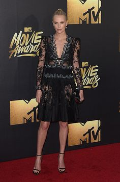 Charlize Theron wearing the Jimmy Choo MINNY sandals at the 2016 #MTVMovieAwards