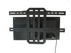 Our Motorized Wall Mount - The best viewing wall mount option out there This wall mount can tilt your TV left - right and up - down via remote Tv Cords, Mount Tv, Design Tech, Cabinet Making, Wall Mounted Tv, Tilt, Cabinets, Remote, House Design