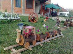 For BRAY--KK -- Cute train made of hollowed out logs! More at: www.diycozyhome.com