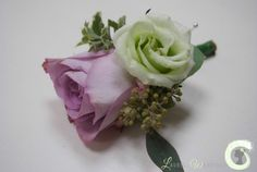 Dusky lilac rose buttonhole with green lisianthus and eucalyptus form Laurel Weddings