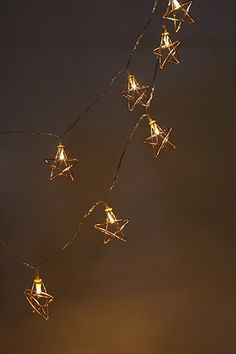 Details Light up your room with these LED star shaped string lights. Content + Care - 10 LED lights - Requires 2 AA batteries (Not included) - For indoor use only Size + Fit - Length: Star String Lights, Star Lights, Art Of Beauty, Room Goals, Pretty Lights, Wire Crafts, Winter Photography, Chandelier Lighting, Chandeliers