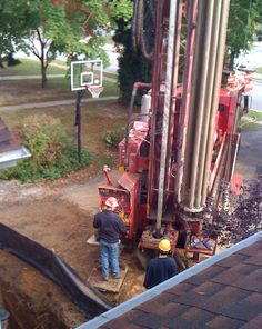 Drilling the wells for the Geothermal HVAC!
