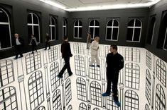 """Brazilian artist Regina Silveira creates visual illusions with this installation in Lodz, Polland. """"Depth"""" incorporated the gallery's architecture to show a never-ending abyss one could walk on."""