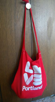 """T-shirt bag #upcycle I """"cheated"""" here an there so mine's not quite as well done, but it's a great idea and I like that I can use the shirt I couldn't wear but didn't want to get rid of. :)"""