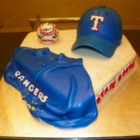 I made this cake for my nephew's basbeball team's bake sale,  home plate and baseball cap are chocolate cake with chocolate BC, covered in fondant.  The baseball was RKT covered in fondant, I signed the players name on the ball to make it look like...