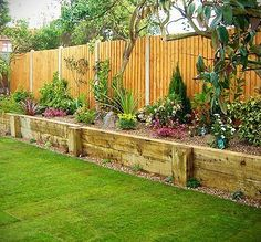 Landscape idea - raised bed next to the fence. This would be great to cover the old dog run area.