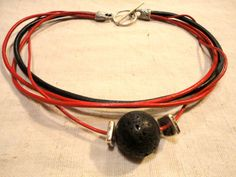 Red and black lava rock and genuine leather necklace // Handmade necklace  Chic, unique and sophisticated.  EUR 30.   Cilck to discover more now   // handmade jewelry // handmade jewellery // lava rock jewelry // lava rock jewellery