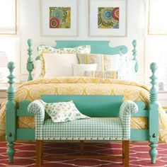 Turquoise and yellow bedding! Love the Bold and dramatic curves on the bedposts and headboard!