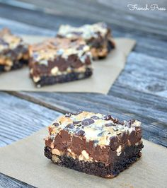 Snickers 7 Layer Bars -- Oreo Crust topped with Sweetened Condensed Milk, Peanuts, Caramel and Chocolate Chips