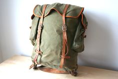 Vintage German DDR East German army issue rucksack backpack bag - green canvas and brown leather with metal frame