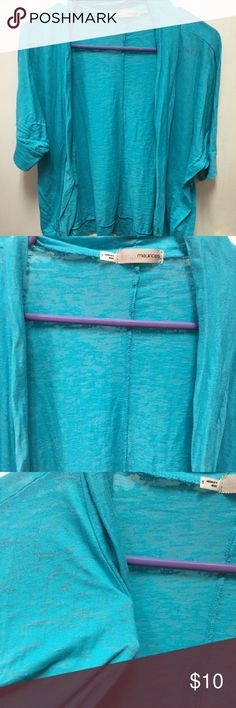 Aqua blue shrug. Super lightweight. Material is like a burn out look. Beautiful aqua blue color. Not as short as cropped, but not real long either. Hits me at about my pants waist when I did wear it. From Maurices. Size 1 (16/18). Maurices Tops