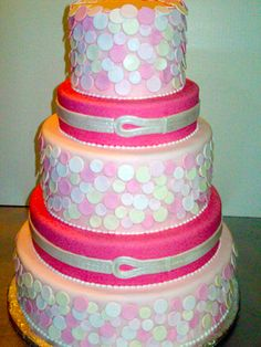 This pretty pink 5-tiered cake features beautiful pink disks, beading detail with a belted effect.  It is perfect for a wedding, bridal shower or birthday party.  www.sweetladiesbakery.com @sweetladiesbake #dc #nova #dmv #wedding #cake