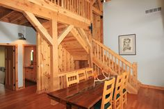 Dining area next to the loft stairs - Rustic | Sand Creek Post & Beam  https://www.facebook.com/SandCreekPostandBeam