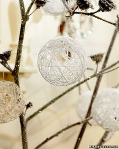 Blow up balloons and dip string in glue and wrap around, let dry over night. Pop balloon and add string, hang on tree