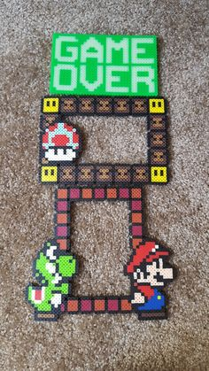 https://www.facebook.com/thatssoperler/ Mario and yoshi picture frame perler beads. Glow in the dark