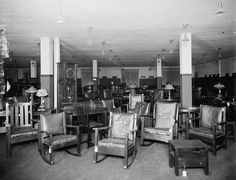 FURNITURE: Examples of the times. Pringle's Showroom, Detroit, 1910. Three rockers in the foreground. also, showing is a mostly glass grandfather clock.