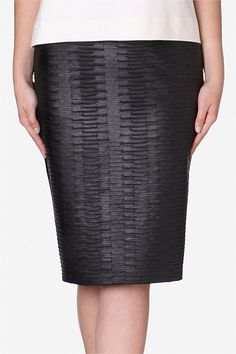 Raven Faux Croc Pencil Skirt   A great foundation for any woman's wardrobe is a classic black pencil skirt. Build this foundational rule by stepping out in textural faux croc that adds depth to closet capsules.Take this silhouette from day-to-night with ease. One of Carla's favourites this season.