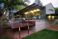 steel structure with wood beams and corrugated galvanized roofing- porch- wall lights and outdoor ceiling fans