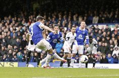22 March 2014 Leighton Baines carefully places his penalty to score against Swansea after Flores had brought down Ross Barkley