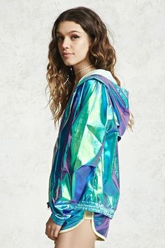 A holographic windbreaker jacket featuring a hood, long sleeves, partial mesh lining, a breathable mesh back panel, slant front pockets, elasticized cuffs and a zip closure.