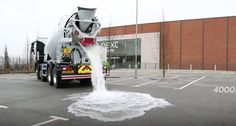 """The building material company Tarmac has developed a new kind of concrete that is capable of absorbing up to 4,000 liters (1057 gallons) of water in the first minute. On average, one square meter of this new road surface, called """"Topmix Permeable,"""" can drain 600 liters (159 gallons) in a minute."""