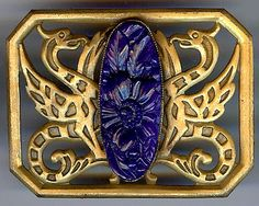 ANTIQUE ART DECO FLYING DRAGONS CARVED BLUE GLASS FLOWER STONE SASH PIN  Sell one like this  	 	  ANTIQUE ART DECO FLYING DRAGONS CARVED BLUE GLASS FLOWER STONE SASH PIN