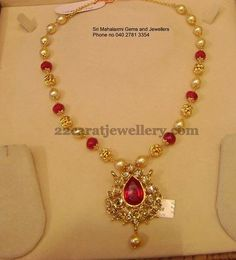 Ruby beads and south sea pearls combination simple necklace with 22 carat gold metal. Nice pachi work pear shaped pendant comes in the ce...