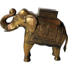 Beautiful Indian elephant plated with engraved brass Indian Elephant, Shimmer N Shine, Wood Sizes, Small Storage, Plating, Lion Sculpture, Iron, Brass, Statue