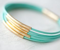 Mint Green Leather Bracelet with 6 Golden tubes by pardes israel