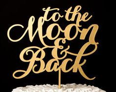 To the Moon and Back wedding cake topper.