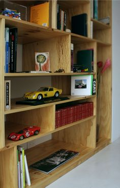 Wooden Bookshelf. Concrete Floor. Modern Apartment.