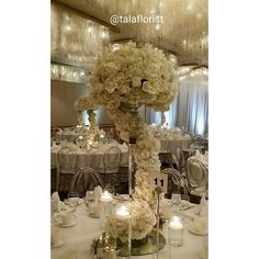 great vancouver wedding #tbt at the always beautiful #panpacific #crystalballroom of these beautiful floral centerpieces that we did this past May. A winding #floralgarland always gives instant #lushness. #allwhitewedding #luxurydesign #luxurious #persianwedding #luxurydecor #springwedding #whiteroses #hydrangeas #crystalstands #crystalchandelier #instaweddings #instalove #talaflorist by @talaflorist  #vancouverpersianwedding #vancouverwedding #vancouverwedding