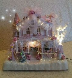 It is a beautiful deep pink. There are 5 pieces to this Victorian village house. The house has an on/off switch with a light inside that brings this beautiful house to life. Shabby Chic Christmas, Christmas Minis, Victorian Christmas, Christmas Design, Christmas Stuff, Christmas Village Houses, Christmas Villages, Pink Christmas Lights, Victorian Village