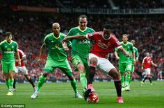Martial fends off the challenge of John O'Shea as he highlights his impressive strength