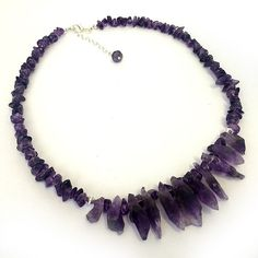 Mulberry Falls Necklace Mulberry Falls is a stunning amethyst statement necklace that has been lovingly handcrafted as part of our Statement Rock jewellery range.  It features beautiful smooth and shiny amethyst chips and amethyst quartz crystal stones and has been finished off with a quality silver plated lobster clasp and charming amethyst bead. www.luxierefashion.co.uk #fashion #style #jewellery