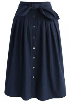 The classy navy midi skirt serves up traditional chic with its button-down detail and simple silhouette. The bowknot at the waste adds a fun, feminine component that'll make this even easier to style!   - Self-tie bow on waist - Buttons decorated front - Pleats from waist - Concealed back zip closure - Lined - 100% Polyester - Hand wash cold  Size(cm)Length  Waist XS      69     64 S       69     68 M      69     72 L       69     76 XL     …