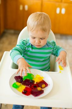What a fun and easy way to introduce babies to new texture.  Who couldn't resist fun jello colors.  And hiding fruit in the jello is genius!...