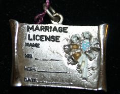Incredible old 3D MARRIAGE LICENSE charm with Enamel 3D FLOWER and designed to be engraved with :his name, her name and date of marriage.