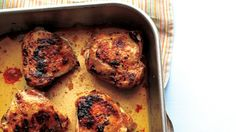 "This roasted chicken recipe showcases juicy, flavorful chicken thighs with a lemony sauce that bakes itself in the pan. Roasted chicken thighs are the ideal weeknight dinner for busy families.Adapted from ""Mad Hungry: Feeding Men and Boys"" by Lucinda Scala Quinn (Artisan; 2009)."