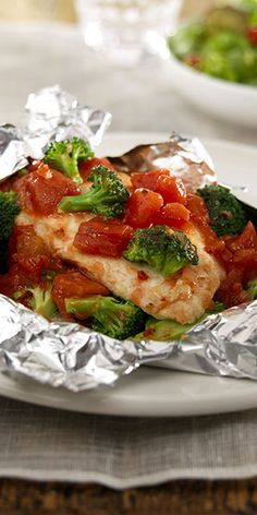 Healthy & Easy: Chicken breast, broccoli and diced tomatoes seasoned with Italian dressing -- cooked together in foil packets for an easy entrée