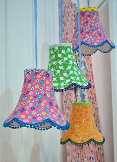 Hanging lamps. Something like these will do. T.C