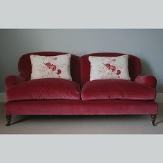 Kate Forman - Kate Forman Fabric Collection - Classic couch with plain red upholstery and two white pillows with watercolour flower images Fabric Sofa, Cushions On Sofa, Sofa Chair, Sofa Upholstery, Cushion Fabric, Vintage Sofa, Red Velvet Sofa, Pink Velvet, Kate Forman