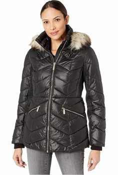 Michael Kors Black Short Down Quilted Puffer Jacket With a Faux-Fur Trim Women's. Women's Quilted Black Puffer Jacket With Faux Fur Trim Hood. Crafted from a quilted poly woven with ribbed internal cuffs at the long sleeves, zipper hand pockets. finish. #PufferCoats #WinterCoats #MichaelKors