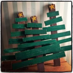 Trees made out of old pallets and scrap wood.