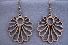 Wood cut fan earrings.