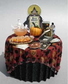 miniature halloween donuts with sprinkles and a halloween kitchen towel with pumpkins miniature halloween and donuts